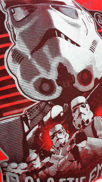"The design features stormtroopers over the words ""Galactic Empire"" with a logo in the top left and designation ""TK 421"" in the top right, all over a red background."