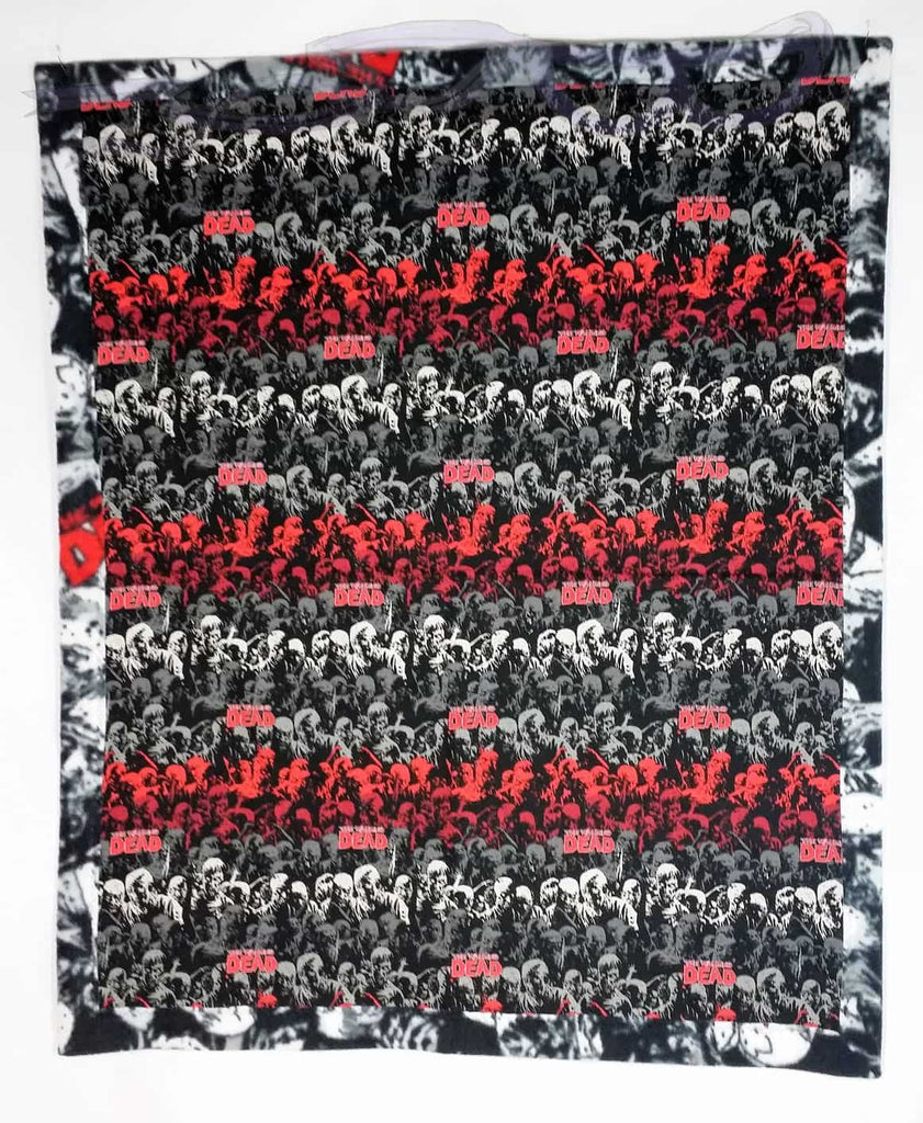 Walking Dead red ombre fabric made into a small blanket. Soft blanket with undead fabric. Zombie bedding made from Walking Dead fabrics