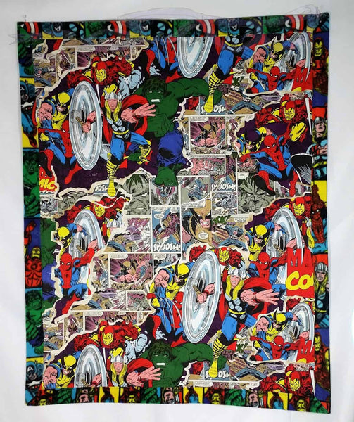 The cotton is a matching side with the heroes joined by Wolverine and the Silver Surfer in the foreground and comic squares in the background. It's a small piece of the MCU chipped off onto a blanket made from Marvel fleece and cotton.