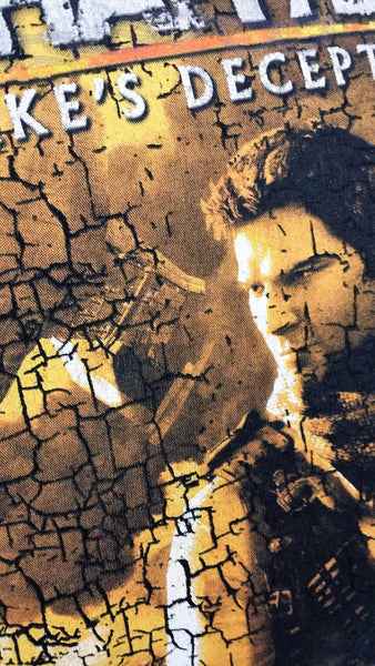 It features Nathan Drake in a cracked desert design under the logo for Drake's Deception, all on a black background.