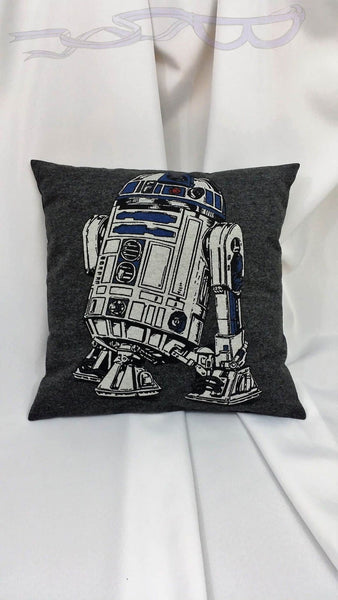 It features the white and blue robot, R2D2, on a gray background.