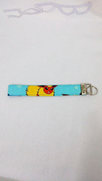 Pokemon fabric made into a video game key chain.