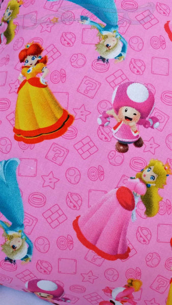 Mario style has a black backing and the Princess one has either a lavender or an orange