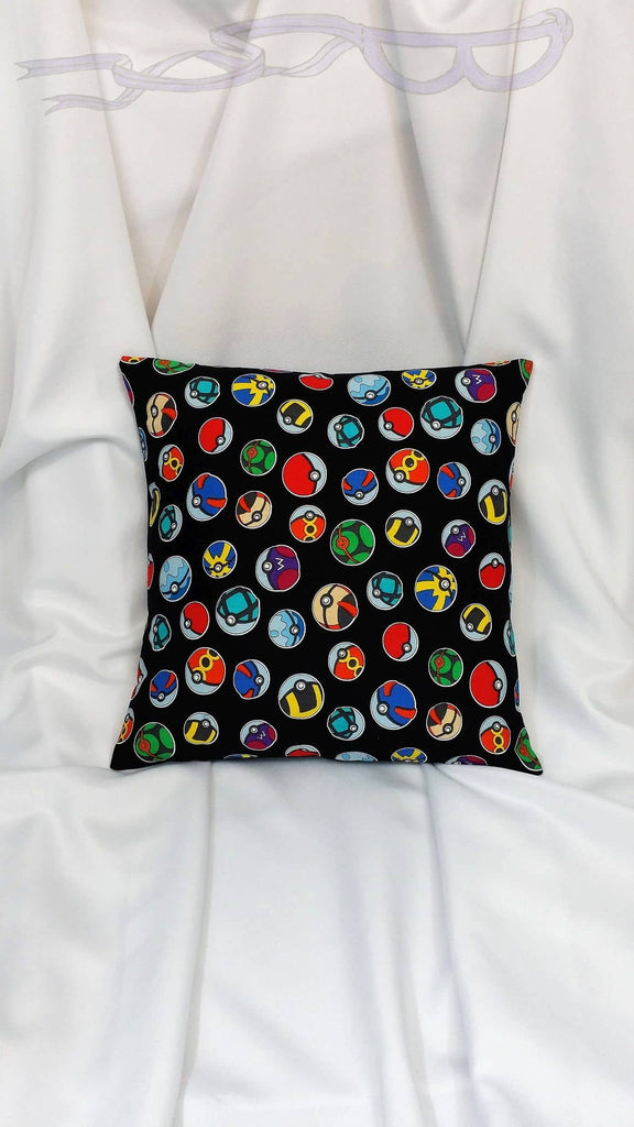 Pokemon fabric made into a cotton throw pillow cover. Video game decor made with Pokeballs fabric.