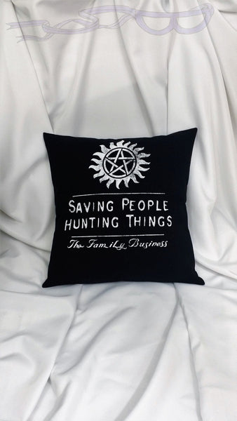 "pentagram encircled in flames over the words, ""Saving People, Hunting Things, The Family Business"" in white on a black background"