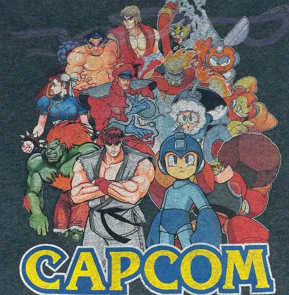 Capcom t shirt made into a throw pillow cover.