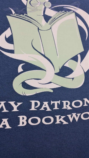 "glow in the dark bookworm with glasses reading intently over the words, ""My Patronus is a Bookworm"" on a dark blue background"