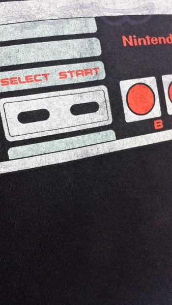 Nintendo Entertainment SystNintendo Entertainment System controller shirt made into a pillow cover. Video game bedding made from NES controller shirt. Old school decor