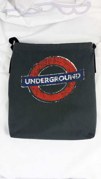 reverse side has the London Underground logo in a sea of gray