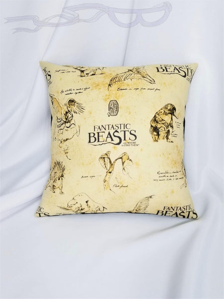 Fantastic Beasts fabric made into a cotton throw pillow cover.