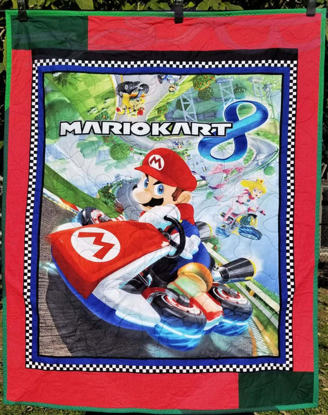 Mario Kart fabric made into a double-sided quilt.