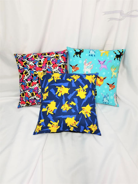 Pokemon Eeveelutions, Fairy, Pikachu, and Pokeballs fabric made into a pillow cover.