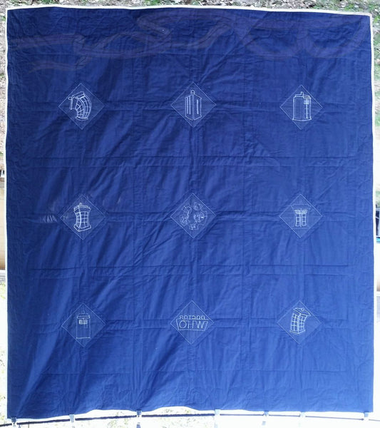 Doctor Who Tardis fabric made into a quilt.