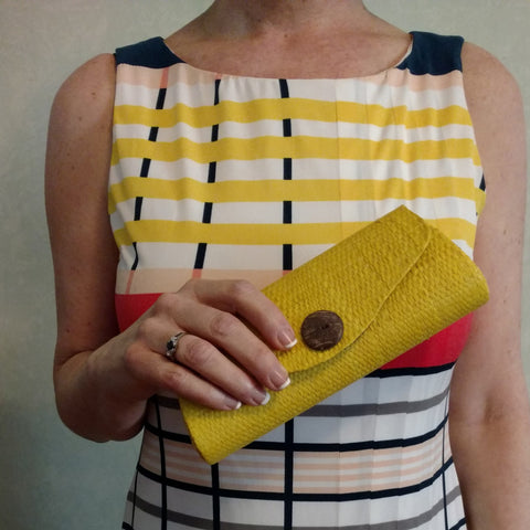 Yellow mini clutch, sunglass case of natural grass; vegan and cruelty-free from Bagnanimous