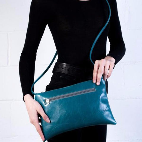 Teal cross body bag from Crystalyn Kae, handmade with vintage fabric lining--cruelty-free
