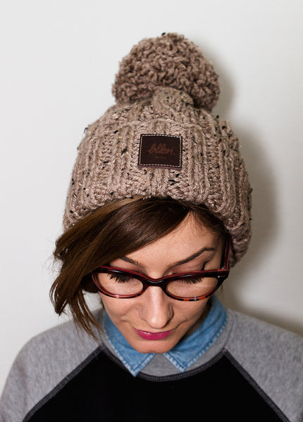 HAND-KNITTED POM BEANIE