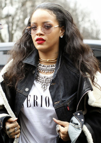 Celebrity trendsetter Rihanna mixes metallic necklaces