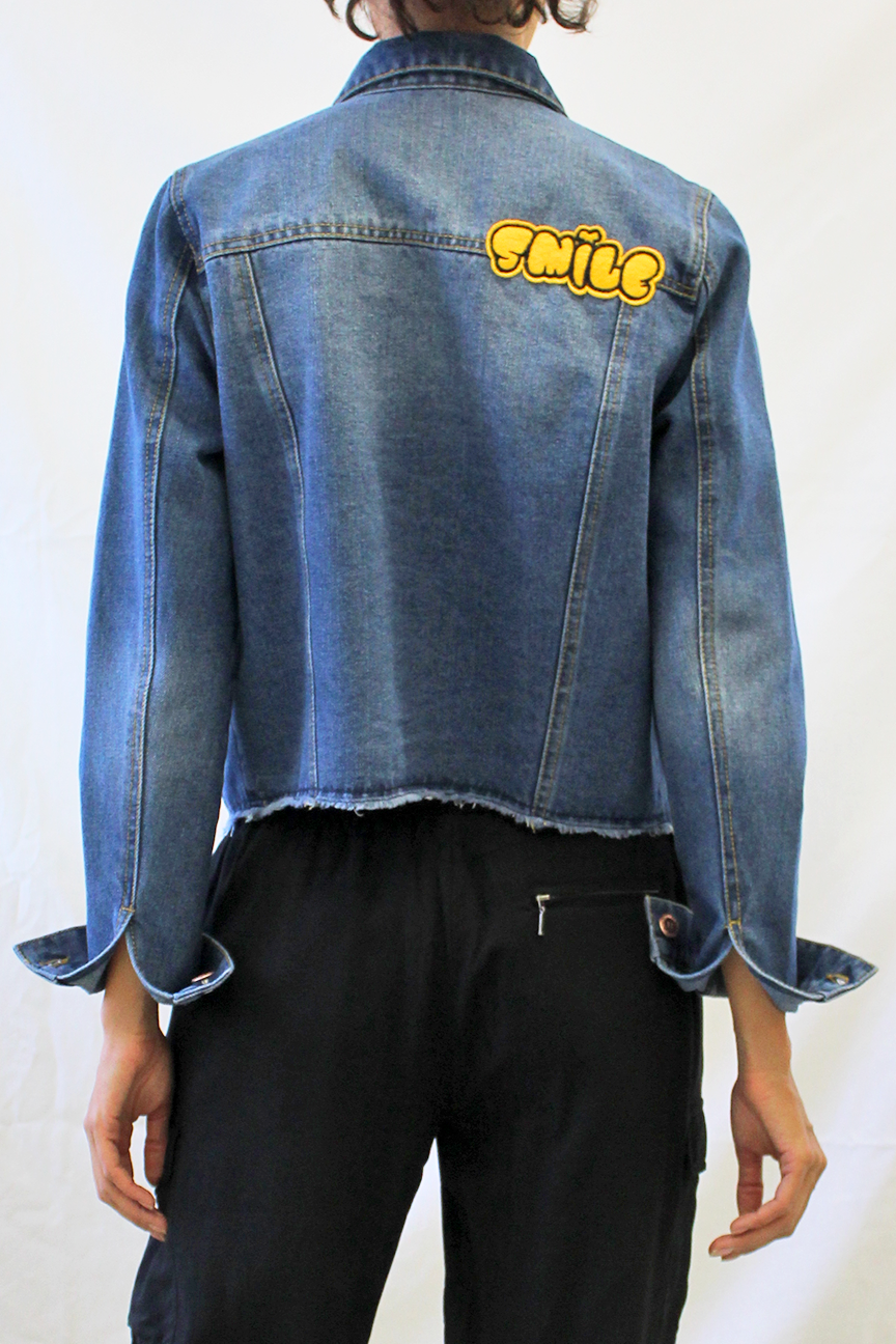 embroidered patched denim jacket with raw hem back photo