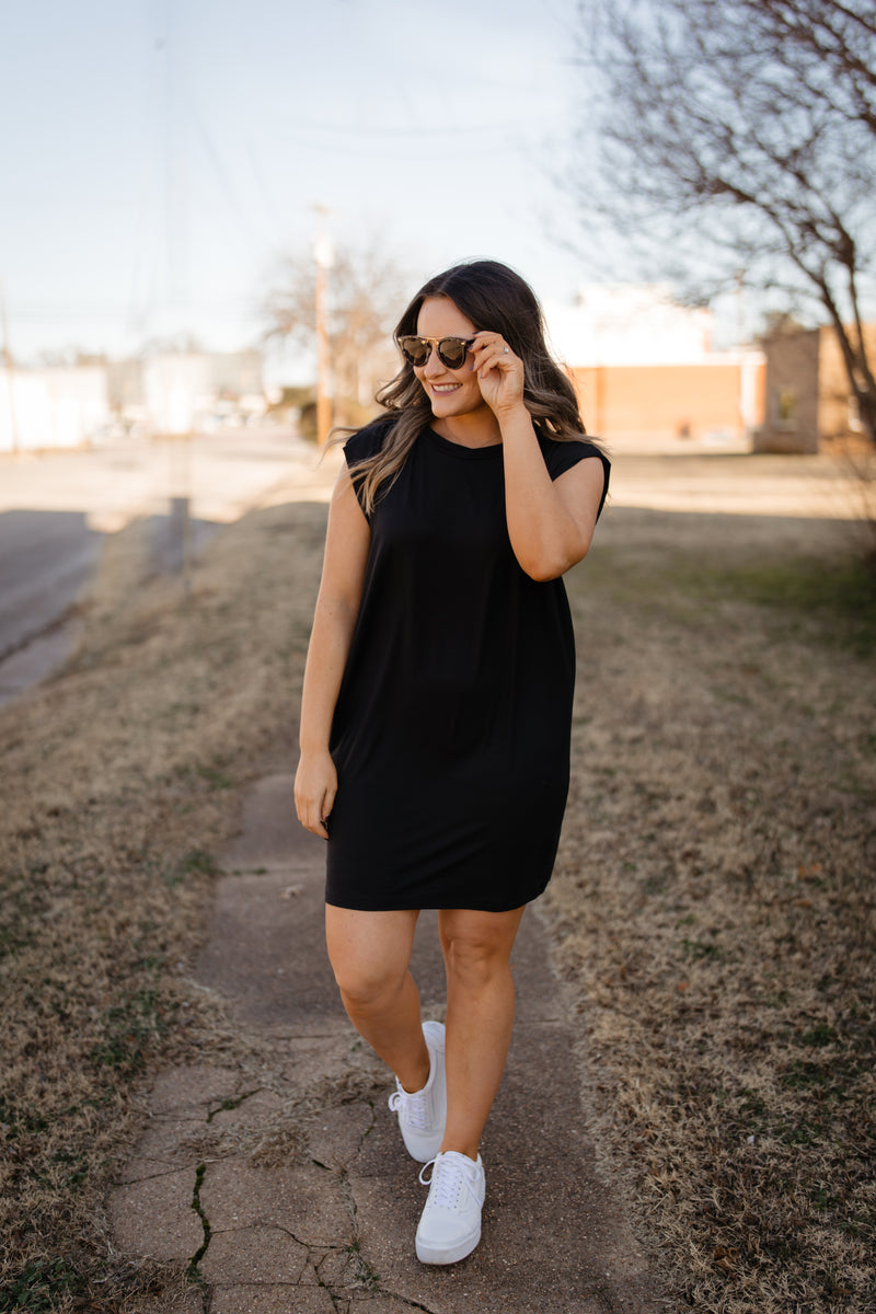 Black shift dress with pockets + shoulder detail.