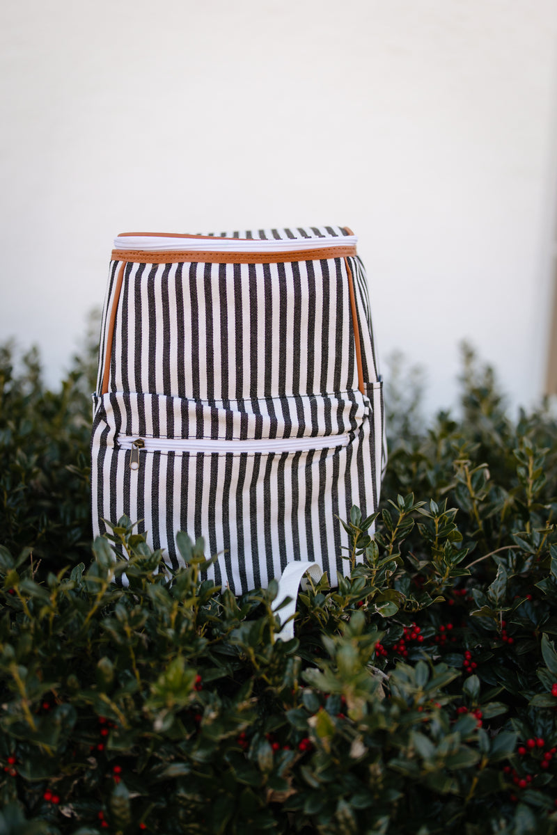 Black and white striped insulated backpack.