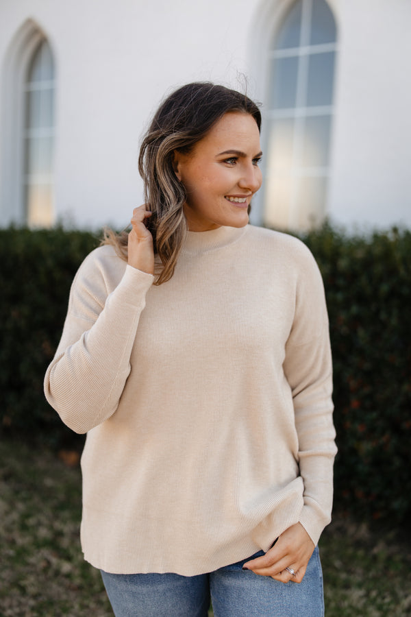 Mock neck pullover sweater top.