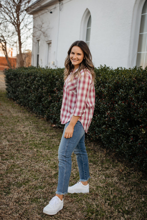 Plaid button up top with wooden buttons.