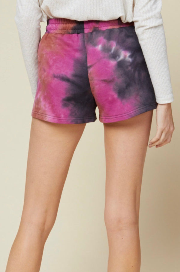 Tie-dye shorts featuring drawstring detail at waist. Pocket detail at front. Unlined. Non-sheer. Knit. Lightweight