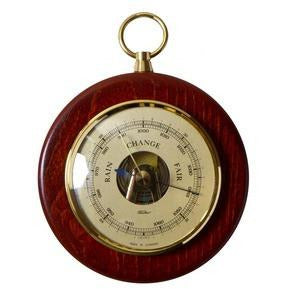 Small round wooden barometer