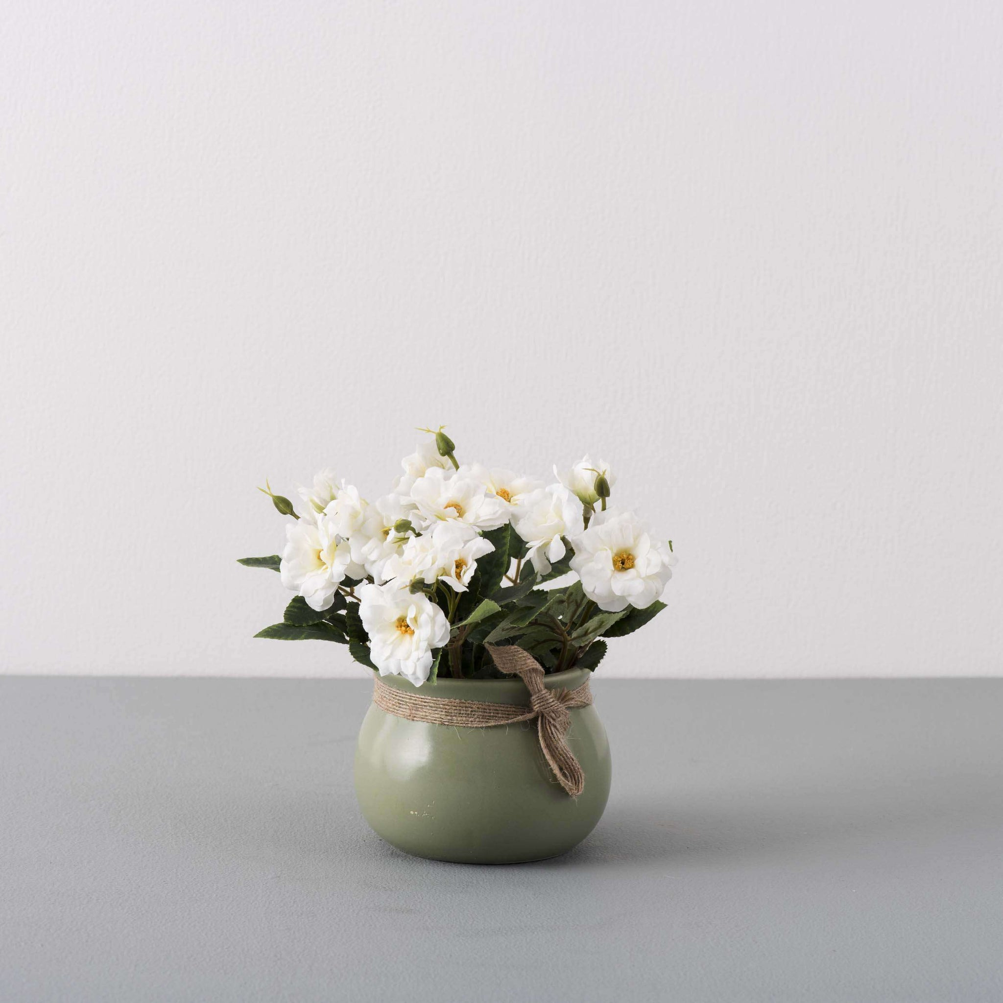 White Silk Flower Arrangement In Pastel Green Planter Thedecorkart