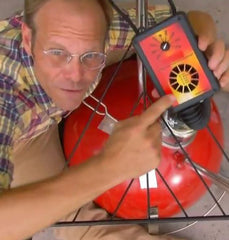Alton Brown and his IQ110 on his famous Weber Kettle, Fireball