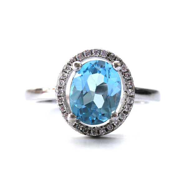 Oval Cut Blue Topaz Halo Ring