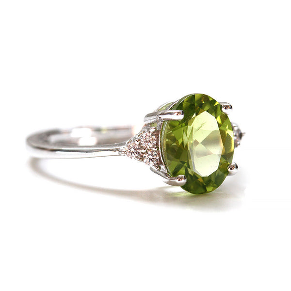 Oval Cut Peridot and Cubic Zirconia Ring