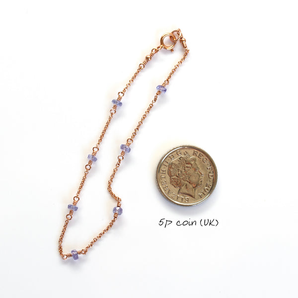 tanzanite braclelet next to 5p coin