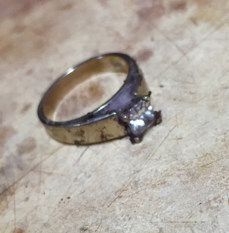 Dirty diamond engagement ring before cleaning and polishing
