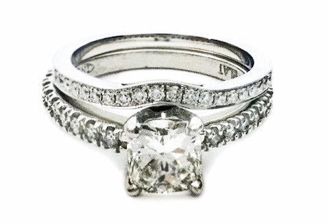 Cushion cut diamond platinum engagement ring and nesting curved platinum and diamond wedding band by Rubini Jewelers