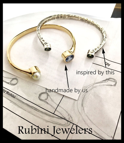 Custom yellow gold pearl and topaz cuff, shown next to the inspirational silver cuff, by Rubini Jewelers