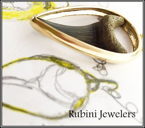 Sideview of custom made 14kt gold and shark tooth pendant by Rubini Jewelers