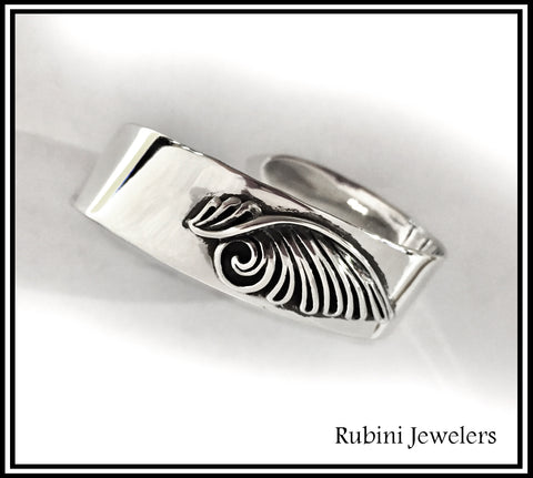 Handmade sterling silver bypass cuff bracelet by Rubini Jewelers, enhanced with customer's existing pendant