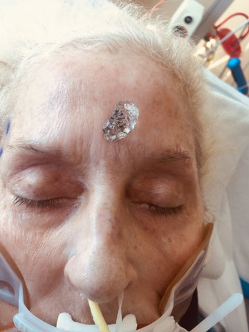 Mama with a crystal on her forehead