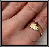 14kt yellow gold oar wrap rowing ring with rhodalite garnet by Rubini Jewelers, shown on size 7.5 index finger