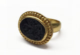 This 22k gold ring features an etching of a man on horseback holding a banner carved into it's solo black stone. Our best guess is that it's St. George and the Dragon. Size 7 1/4