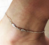 Two Petite Rowing Tulip Blades with Figaro Chain Anklet by Rubini Jewelers