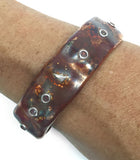 Copper and Silver Ocean Inspired Cuff Bracelet by Rubini Jewelers, on wrist