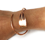 Copper Plated Extra Large Tulip Oar Wrap Rowing Bracelet, by Rubini Jewelers, shown on wrist