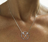 Necklace: lg. circle with rowing crossed oars on box chain by Rubini Jewelers