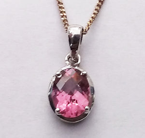An attractive faceted 8x6mm tourmaline set in sterling silver.
