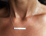 Silver Bar Necklace with Diamond by Rubini Jewelers, shown on neck