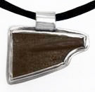 Pendant: carved leather blade bezeled in sterling silver, by Rubini Jewelers