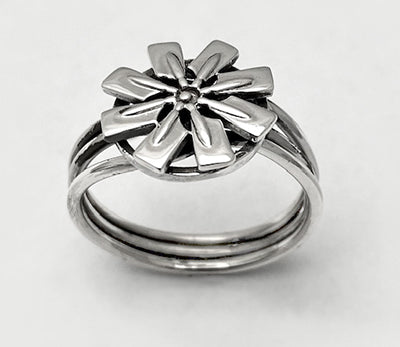 Spinnable Flower of Eight Rowing Hatchet Blades Ring by Rubini Jewelers