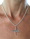 St. Bridget's Silver Cross by Rubini Jewelers, shown on 2.8mm cable chain on woman's neck